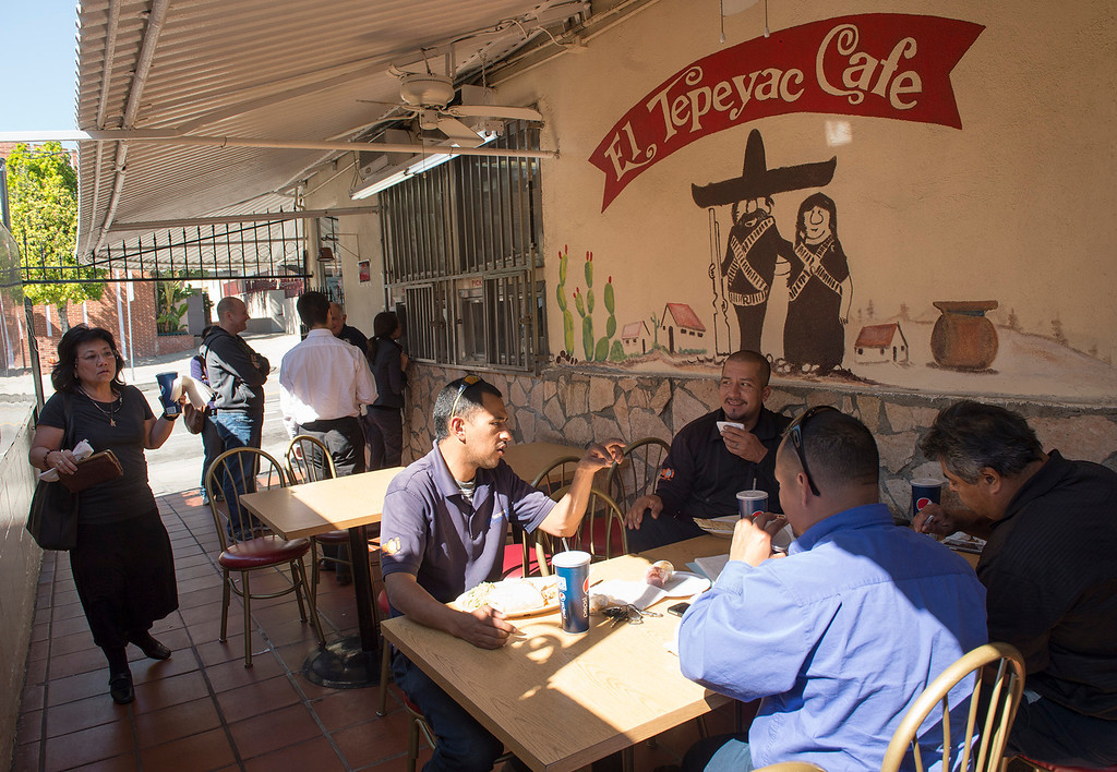 Description of . Diners arrive for lunch at Manuel's Original El Tepeyac Cafe on Evergreen Avenue in Boyle Heights Feb. 25, 2013.  The rosary for owner Manuel Rojas, who died Feb. 11, will be tonight at Assumption Church, across the street from the restaurant.  (SGVN/Staff photo by Leo Jarzomb)