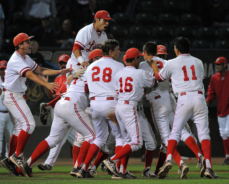 . LONG BEACH - 05/01/13 - (Photo: Scott Varley, Los Angeles Newspaper Group)  Lakewood vs Millikan baseball at Blair Field. Lakewood won 4-3. Lakewood players celebrate their win in the bottom of the 7th.