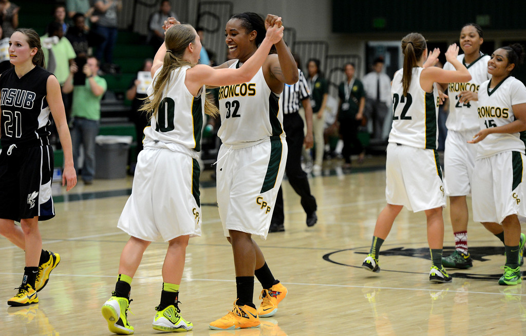 Description of . Cal Poly Pomona's Ariel Marsh and Jada Blackwell celebrate their win over Montana State Billings during the NCAA Division II West Regional championship game at Cal Poly Pomona in Pomona, CA, Monday, March 17, 2014. (Photo by Jennifer Cappuccio Maher/Inland Valley Daily Bulletin)