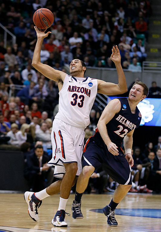 . Belmont\'s Reece Chamberline (22) and Arizona\'s Grant Jerrett (33) fight for a ball in the second half during a second-round game in the NCAA college basketball tournament in Salt Lake City, Thursday, March 21, 2013. Arizona won 81-64. (AP Photo/George Frey)