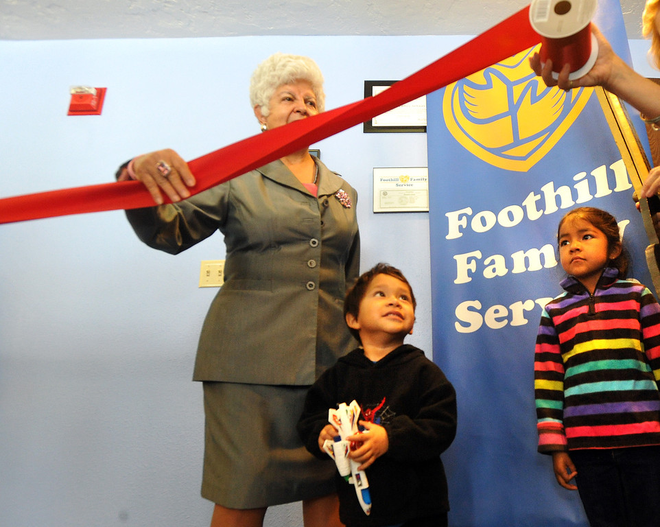 Description of . Jay, 3, and Yvonne Solorio, 6, help Congresswoman Grace Napolitano with the ribbon cutting at Foothill Family Service's new El Monte South Family Center on Tuesday April 2, 2013. The family center provides mental health and social services for children and families in the greater El Monte area, including Early Head Start and school-based mental health services at local schools. (SGVN/Staff Photo by Keith Durflinger)