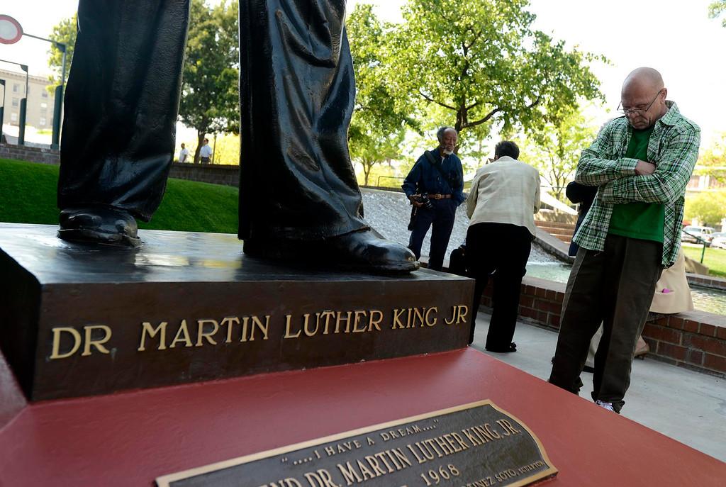 Description of . Robert Earl Luckett, of San Bernardino, admires the newly restored Martin Luther King, Jr. statue in downtown San Bernardino April 12, 2013.  GABRIEL LUIS ACOSTA/STAFF PHOTOGRAPHER.