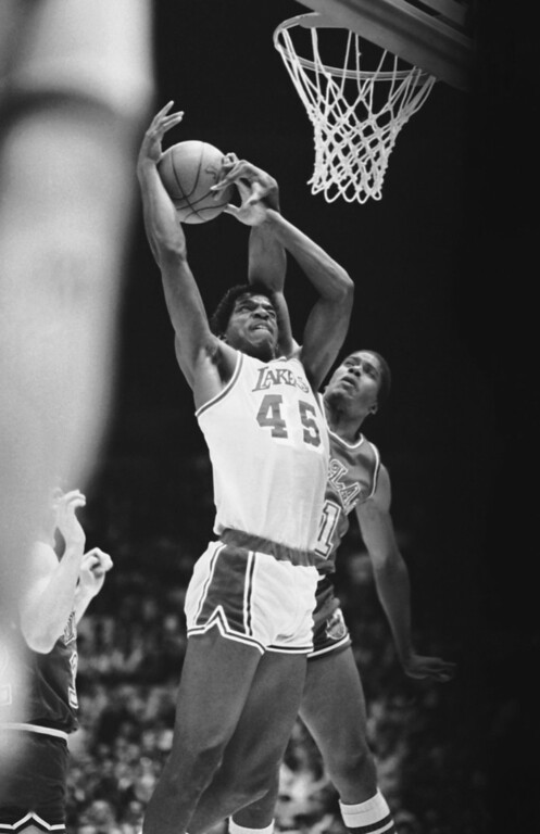 . A.C. Green of the Los Angeles Lakers has a hard time against Jay Vincent of the Dallas Mavericks as Vincent gets his hand on the ball on Tuesday night, May 7, 1986 at the Forum in Inglewood, Calif. The Lakers won the NBA Playoff game 116-113. (AP Photo/Jeff Scheid)