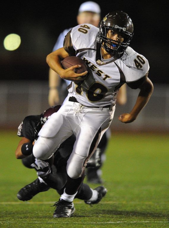 . West High takes on Torrance in a non league football game at Zamperini Stadium in Torrance, CA on Thursday, September 12, 2013. West won 46-7. West\'s #40 (name not on roster) finds running room. (Photo by Scott Varley, Daily Breeze)