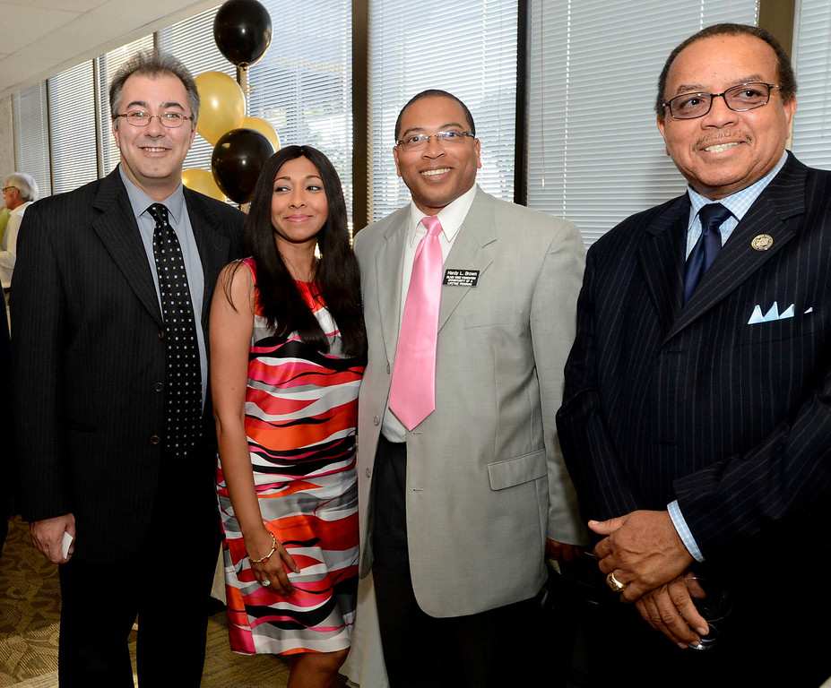 Description of . From left to right:  Frank Pine, Syeda Jafri, Hardy Brown, and Dr. Harold Cebrun, Sr. pose for a photo during The Sun's Open House in downtown San Bernardino March 13, 2013.   GABRIEL LUIS ACOSTA/STAFF PHOTOGRAPHER.