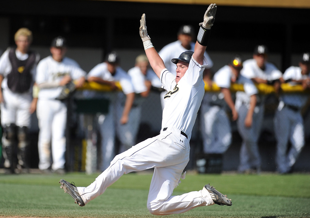 Description of . Northview's Kollby Oriti scores on a wild pitch in the third inning of a prep baseball game against Baldwin Park at Northview High School on Tuesday, April 23, 2012 in Covina, Calif. Northview won 8-2.    (Keith Birmingham/Pasadena Star-News)