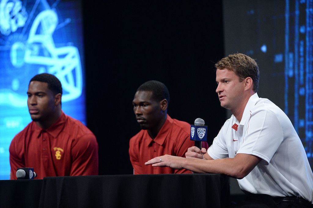 . USC players Hayes Pullard, Marqise Lee and Coach Lane Kiffin. Pac12 media Day at Sony Studios.  Photo by Brad Graverson 7-26-13
