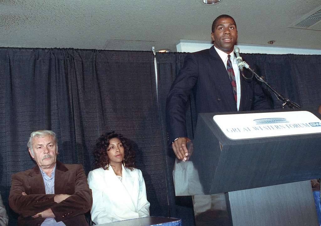 ". Earvin ""Magic\"" Johnson announces his retirement from the Los Angeles Lakers as Lakers\' owner Dr. Jerry Buss, left, and Johnson\'s wife Earletha, known as Cookie, center, listen during a press conference Nov.7, 1991 at the Forum in Inglewood, Calif.  Johnson said he decided to retIre from professional basketball after testing positive for the AIDS virus. (AP Photo/Nick Ut) Earletha (Cookie) Kelley"