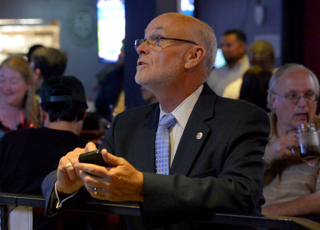 . Torrance mayoral candidate Pat Furey takes a break from his election party to look over early result numbers at Industry Bar in Torrance, CA on Tuesday, June 3, 2014. (Photo by Scott Varley, Daily Breeze)