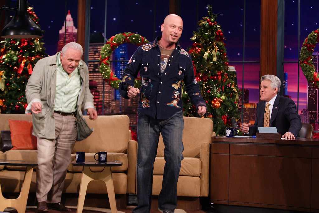 """. Host Jay Leno, right, watches Anthony Hopkins, left, and comedian Howie Mandel dance during the taping of  \""""The Tonight Show with Jay Leno,\"""" Monday, Dec. 12, 2005, in Burbank, Calif. (AP Photo/NBC, Margaret Norton) ** NO SALES **"""