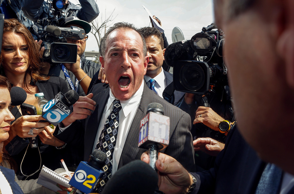 . Michael Lohan, father of actress Lindsay Lohan, speaks to the media as he leaves the Los Angeles County on Monday, March 18, 2013. Lohan accepted a plea deal on Monday in a misdemeanor car crash case that includes 90 days in a rehabilitation facility. The actress, who has struggled for years with legal problems, pleaded no contest to reckless driving, lying to police and obstructing officers who were investigating the accident involving the actress in June. (AP Photo/Damian Dovarganes)
