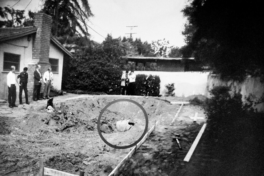 Description of . A projected photo on the screen to the jurors, showing where a container was found with the body of John Sohus, when a pool was being dug at the home on Lorraine Road in 1985 in San Marino.The murder trial of Christian Gerhartsreiter, 52,  known as