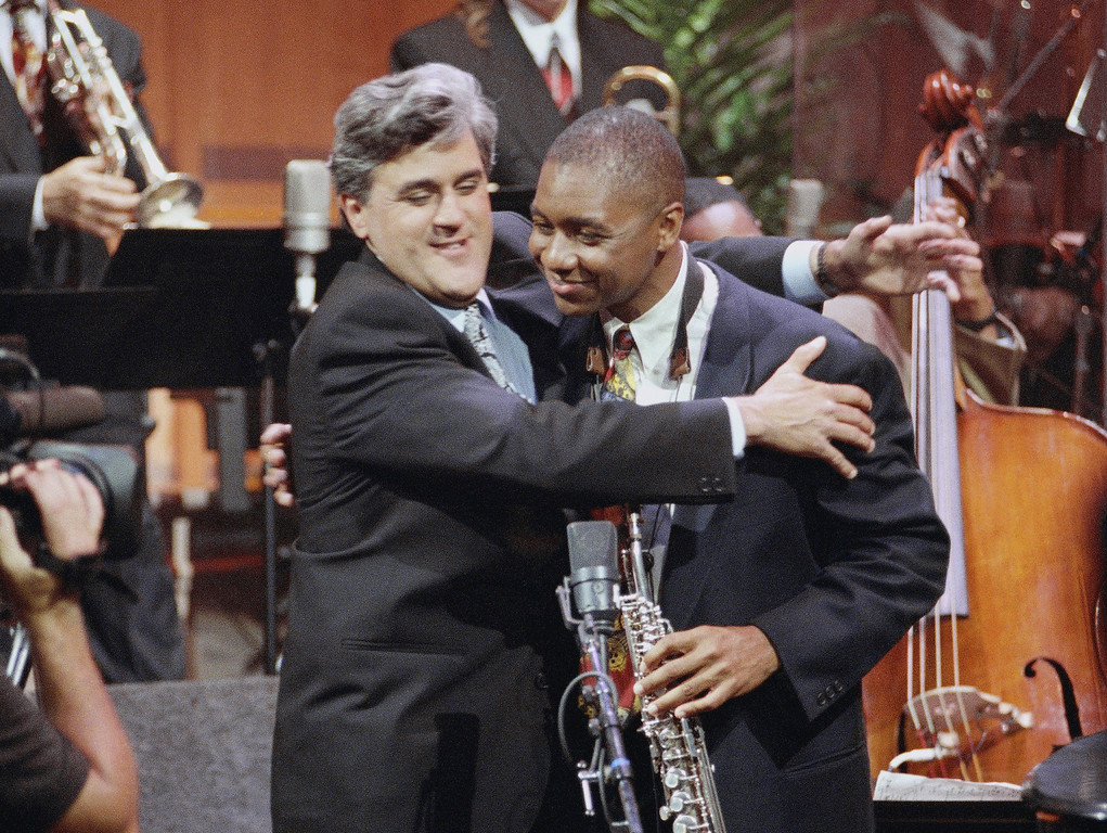 """. Jay Leno, left, hugs Branford Marsalis during the inauguration of \""""The Tonight Show With Jay Leno\"""" which was broadcast live on the east coast from NBC Studios in Burbank, Calif., May 26, 1992. The show features a new band with Marsalis as musical director. Leno\'s first guests were comedian Billy Crystal and singer Shanice. (AP Photo/Craig Fujii)"""