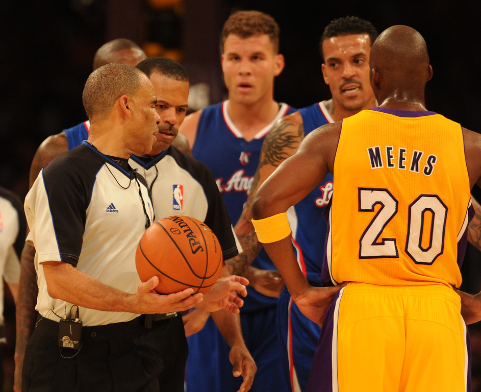 . Officials discus a foul by Clippers#22 Matt Barnes  in the first half. The Los Angeles Lakers played the Los Angeles Clippers in the opening game of the season at Staples Center. Los Angeles, CA. 10/29/2013. photo by (John McCoy/Los Angeles Daily News)