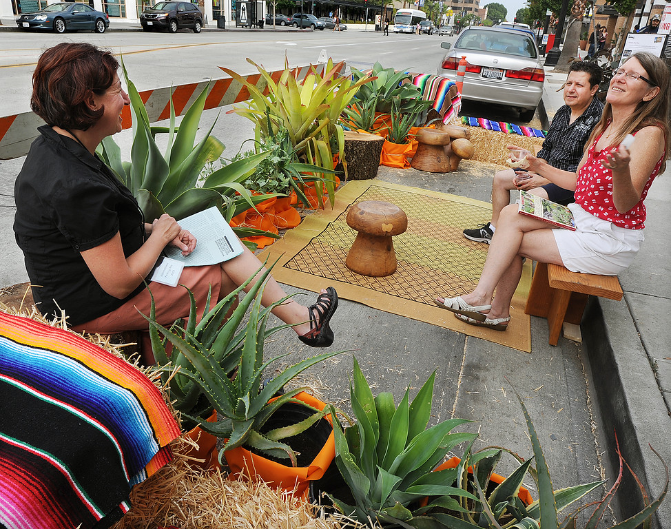 Description of . Blair Miller, left, Wafic, and Sylvia Holmes enjoy conversation during PARKday in front on Colorado Boulevard. On Friday, September 20th on Colorado Boulevard in front of Yahaira's Cafe in the  Pasadena's Playhouse District,celebrated international PARK(ing) Day by transforming two parking spaces into temporary parklets. Pasadena is the first city in San Gabriel Valley to participate in this worldwide grassroots event.(Photo by Walt Mancini/Pasadena Star-News)