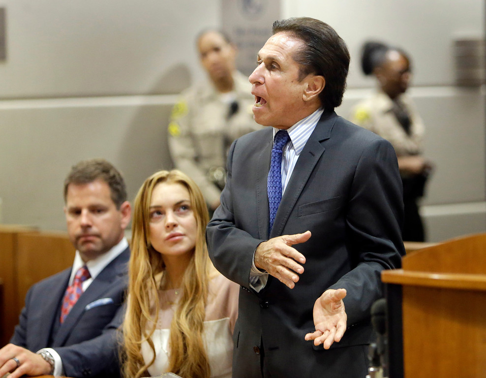 . Actress Lindsay Lohan, and attorneys Mark Heller, right, and Anthony Falangetti appear at a hearing in Los Angeles Superior Court Monday, March 18, 2013. Lohan accepted a plea deal on Monday in a misdemeanor car crash case that includes 90 days in a rehabilitation facility. The actress, who has struggled for years with legal problems, pleaded no contest to reckless driving, lying to police and obstructing officers who were investigating the accident involving the actress in June. (AP Photo/Reed Saxon, Pool)