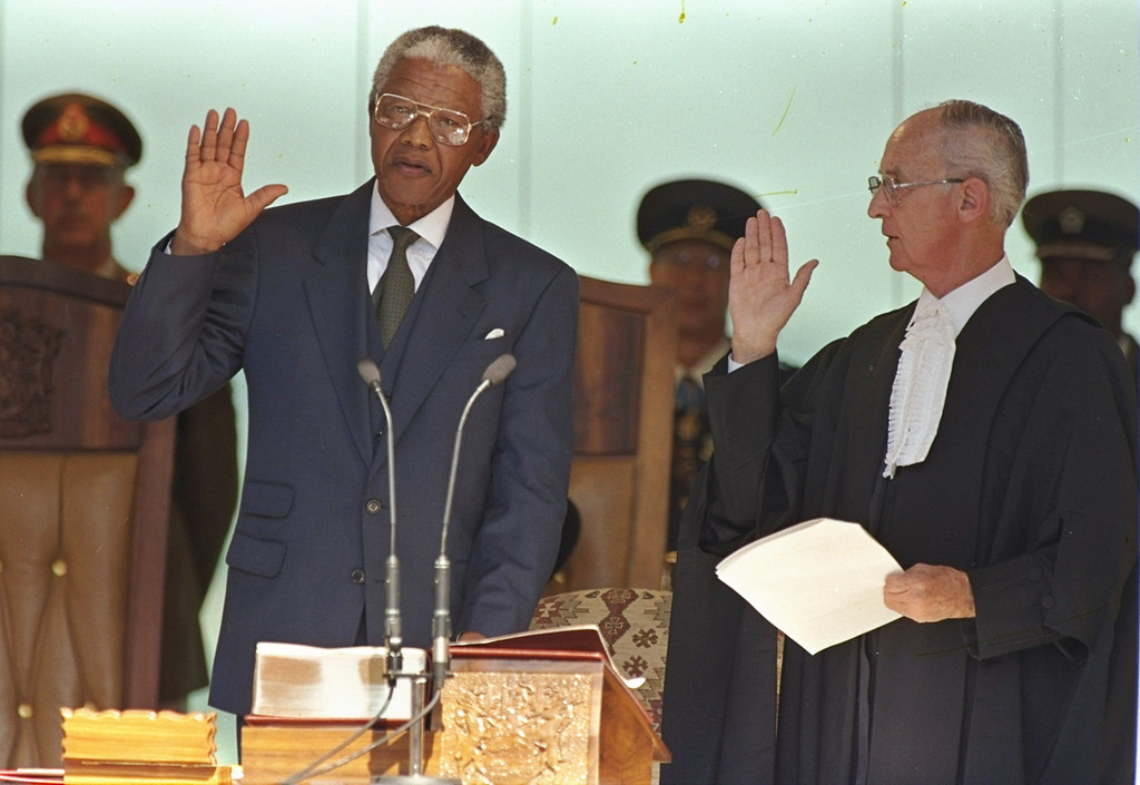 . Nelson Mandela takes the oath of office in Pretoria Tuesday, May 10, 1994 to become South Africa\'s first black President.  The event was attended by many visiting heads of state and thousands of supporters.  (AP Photo/David Brauchli)