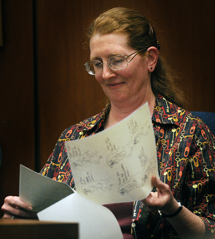 Description of . Susan Coffman, a longtime friend of Linda Sohus identifies drawings and notes that Linda Sohus took during a party they attended, as she testifies in the Christian Karl Gerhartsreiter, murder trial at Clara Shortridge Foltz Criminal Justice Center in Los Angeles Monday, March 25, 2013.  A prosecutor told jurors Monday he will prove a cold-case murder allegation against the German immigrant who spent years moving through U.S. society under a series of aliases, most notoriously posing as a member of the fabled Rockefeller family. He has pleaded not guilty to the killing of John Sohus, 27, who disappeared with his wife, Linda, in 1985 while Gerhartsreiter, using an alias was a guest cottage tenant at the home of Sohus' mother, where the couple lived.(Photo by Walter Mancini, SGVN)