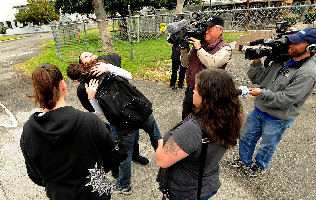 Description of . Dave Thomas, 36, of San Bernardino, hugs supporter Maria Sanchez, of Riverisde, outside the City Animal Shelter in San Bernardino February 19, 2013.  GABRIEL LUIS ACOSTA/STAFF PHOTOGRAPER.
