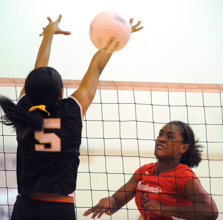 . Redondo girls volleyball takes on Bishop Montgomery in a non league match in Torrance on 09/10/2013. Redondo won 3-0. Redondo\'s Kristen Hamlin drills the ball around the block of Ashley Murray. (Photo by Scott Varley, Daily Breeze)