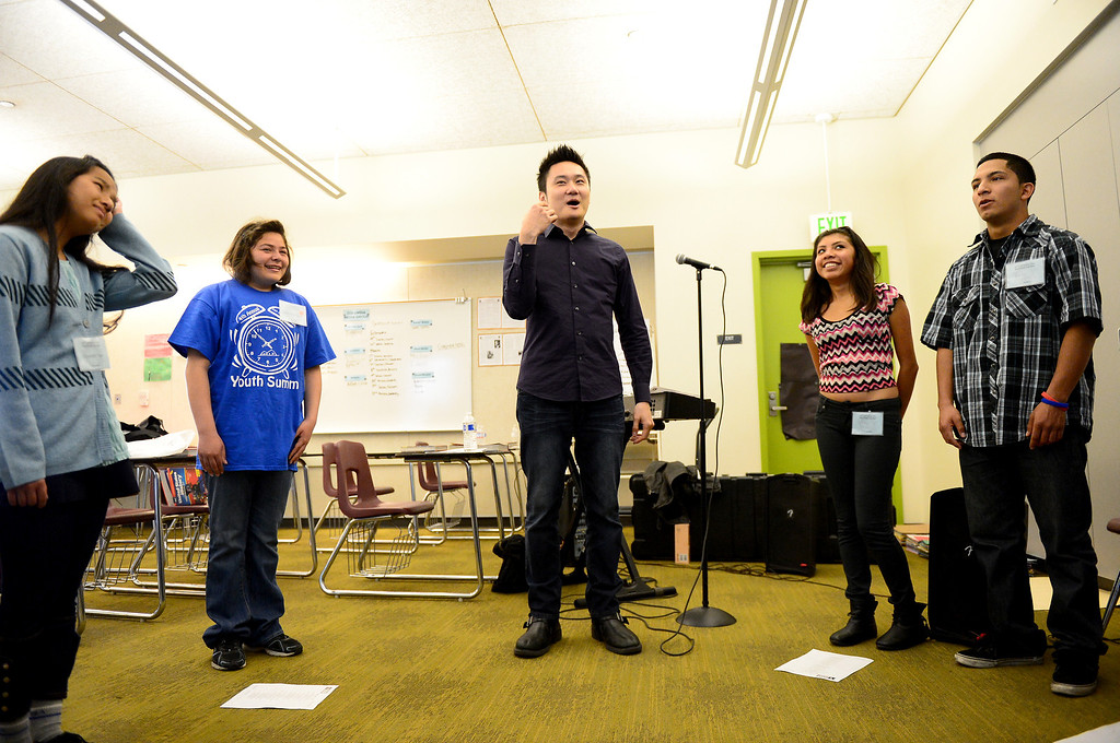 Description of . Paul Kwo leads a Pop Rock Vocal workshop during the 4th Annual San Gabriel Youth Summit at Columbia School in El Monte Saturday, March 23, 2013. (SGVN/Staff Photo by Sarah Reingewirtz)