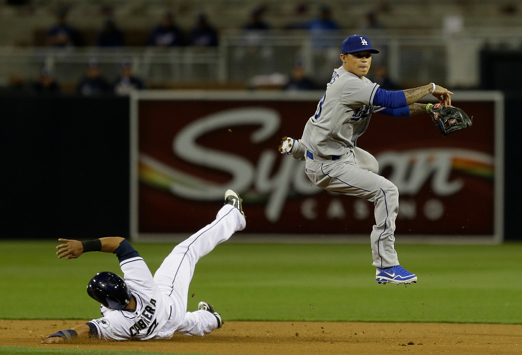 . Los Angeles Dodgers shortstop Justin Sellers relays to first to get a double play after forcing San Diego Padres\' Everth Cabrera at second to end the first inning of a baseball game in San Diego, Wednesday, April 10, 2013. (AP Photo/Lenny Ignelzi)