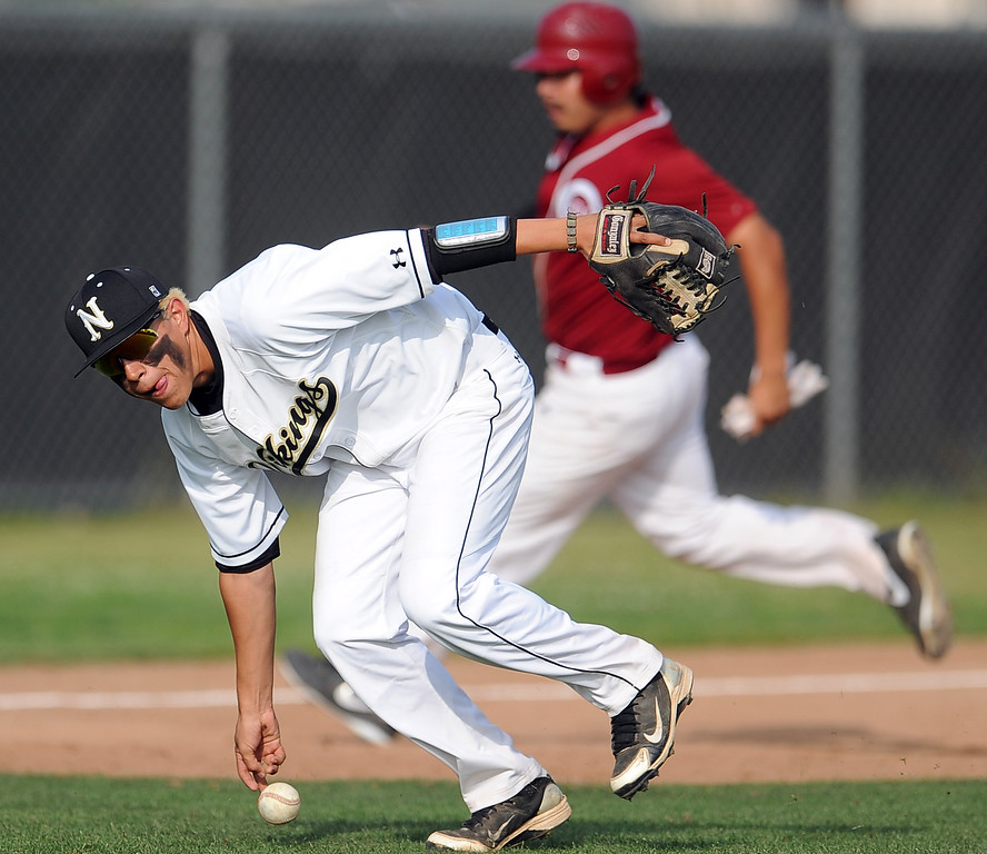 Description of . Northview third baseman Adrian Sabatino miss plays a ground ball by Covina's Daziel Rodriguez (not pictured) in the sixth inning of a prep baseball game at Northview High School on Tuesday, March 19, 2013 in Covina, Calif. Covina won 4-3.  (Keith Birmingham Pasadena Star-News)