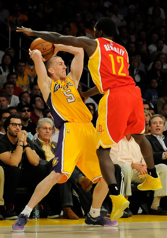 . Lakers#5 Steve Blake gets hassled by Rockets#12 Patrick Beverly late in the 4th quarter. The Lakers defeated the Houston Rockets in overtime 99-95 in the final home game of the year at Staples Center in Los Angeles, CA 4/17/2013(John McCoy/Staff Photographer