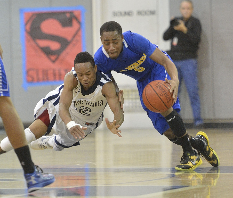. LAKEWOOD, CALIF. USA -- Mayfair\'s Jarrod Sheffield (12) and La Mirada\'s Tyler Payne (5) battle for the ball in Lakewood, Calif., on February 8, 2013. Mayfair defeated La Mirada 60 to 59. Photo by Jeff Gritchen / Los Angeles Newspaper Group