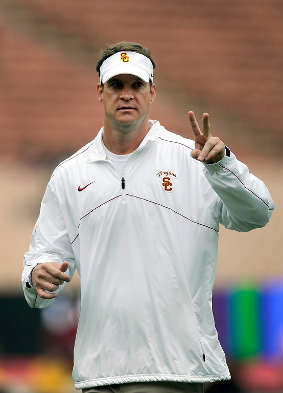 . Head coach Lane Kiffin acknowledges fans at USC\'s Spring Football Game at the L.A. Memorial Coliseum, Saturday, April 13, 2013. (Michael Owen Baker/Staff Photographer)