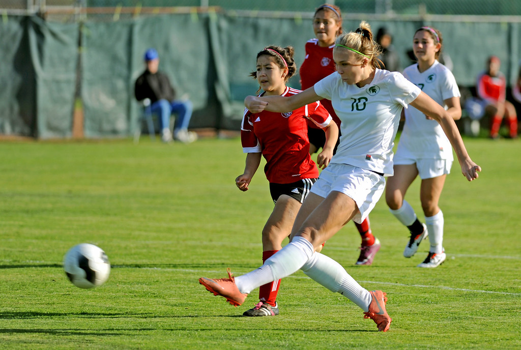 . 02-21-2012--(LANG Staff Photo by Sean Hiller)- South Torrance girls soccer beat Artesia 5-0 in Thursday\'s CIF Southern Section Division IV quarterfinal at South High. Kyla Diekmann (10) over powers Artesia\'s Andrea Murguia (18).