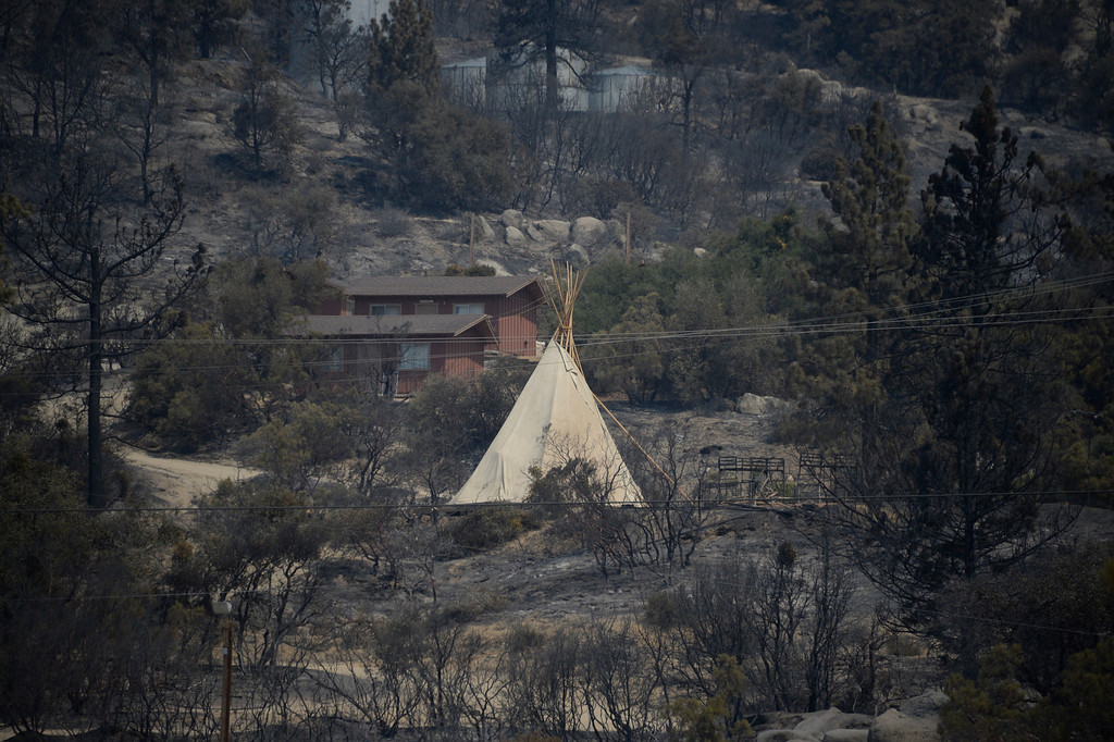 . A Indian Teepee some how survived the heavy fire destruction around it during the Mountain Fire near Idyllwild, California July 18, 2013. The blaze erupted on Monday afternoon about 100 miles (161 km) east of Los Angeles in the scenic but rugged San Jacinto Mountains that overlook Palm Springs, Rancho Mirage and several smaller desert towns.  Photo by Gene Blevins/LA Dailynews