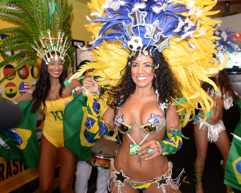 . Marisa Cortez dances with the Los Angeles Samba Dancers as Brazil soccer fans crowded into Samba restaurant to watch the FIFA World Cup game against Croatia Thursday, June 12, 2014, Redondo Beach, CA.  The South Bay is home to a large Brazilian community. Photo by Steve McCrank/Daily Breeze