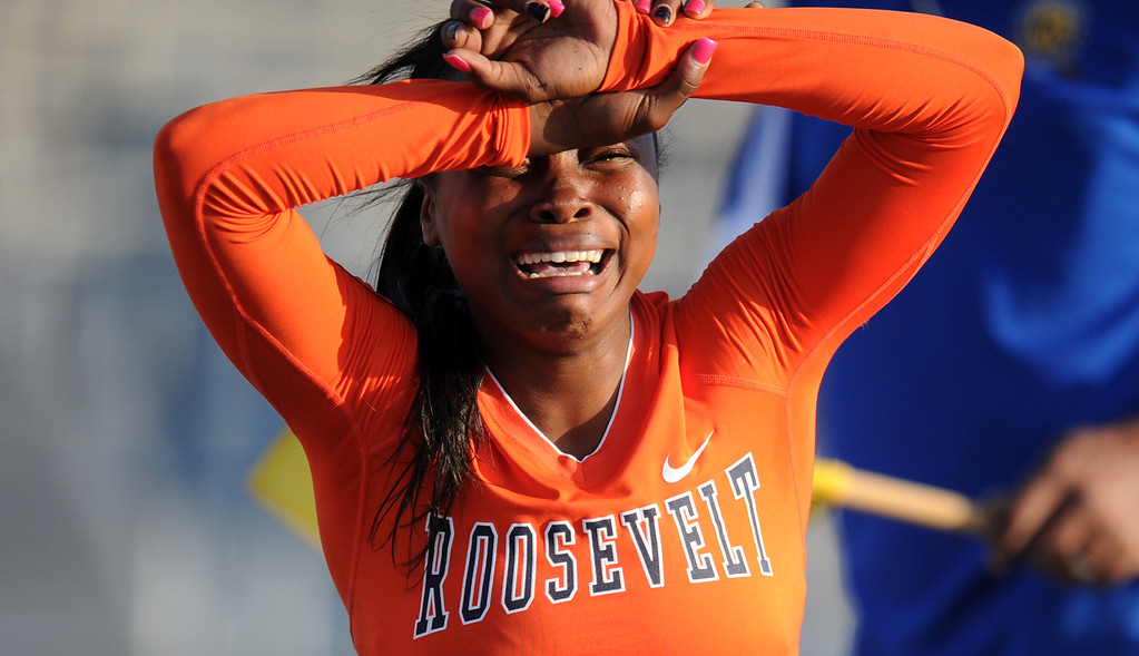 . Roosevelt\'s Jasmyne Graham reacts after hitting a hurdle and finishing last in the 100 hurdles during the CIF-SS Masters Meet at Cerritos College on Friday, May 24, 2013 in Norwalk, Calif.  (Keith Birmingham Pasadena Star-News)