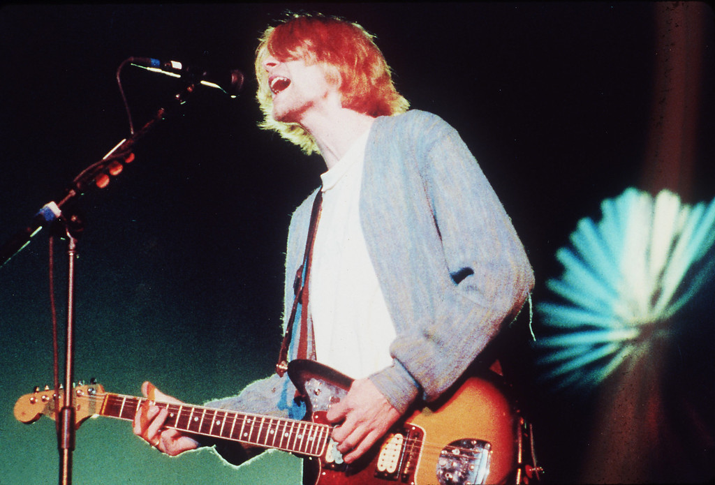 Description of . Kurt Cobain lives on in a  DVD.   (AP Photo/Sam Morris)