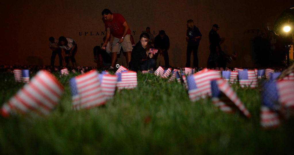 Description of . Volunteers place 2,977 flags outside Upland City Hall in Upland, CA to commemorate the anniversary of 9/11 Wednesday, September 11, 2013. (Jennifer Cappuccio Maher/Inland Valley Daily Bulletin)