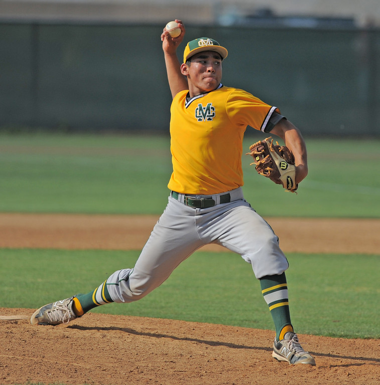 . 05-28-2013-( Sean Hiller/LANG) Mira Costa beat Elsinore 5-3 in Tuesday\'s CIF Southern Section Division III semifinal at Elsinore High School. Costa pitcher Gordon Cardenas throws the final pitch.