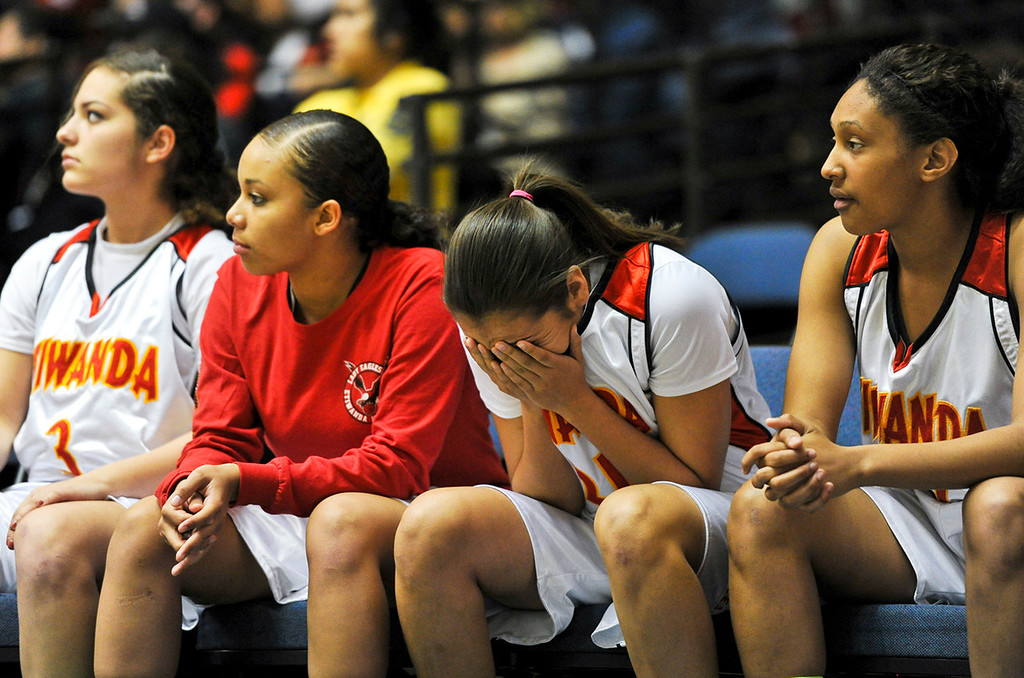 Description of . Etiwanda reacts as they lose the final quarter to Santiago High School during the CIF-SS Div. I-AA Girls Basketball Championship game at the Anaheim Convention Center on Friday, Mar. 1, 2013. Etiwanda was defeated by Santiago 70-65. (Rachel Luna / Staff Photographer)
