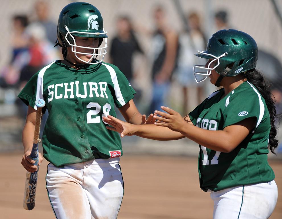 Description of . Montebello plays Schurr in their Almont League girls softball game at Montebello High School on Thursday April 18, 2013. Montebello beat Schurr 10-8. (SGVN/Staff Photo by Keith Durflinger)