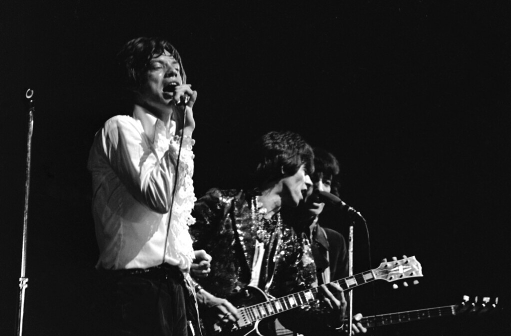 . The Rolling Stones performing at L\'Olympia in Paris, France on April 11, 1967. Band members L-R: Mick Jagger; Keith Richards; and Bill Wyman. (AP Photo/Eustache Cardenas)