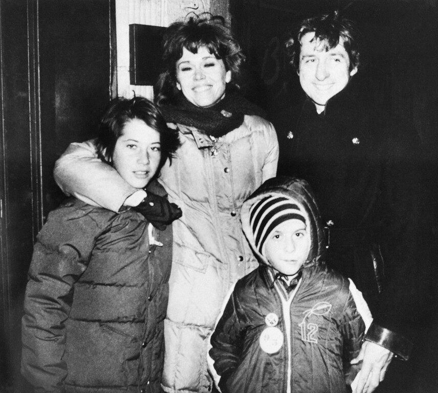""". Actress Jane Fonda and husband Tom Hayden stand with children Vanessa Vadim, left, and Troy after leaving a New York restaurant, on January 24, 1981.    Fonda is in New York for the filming of her movie \""""Roll Over,\"""" co-starring Kris Kristofferson    (AP Photo/Steve Sands)"""