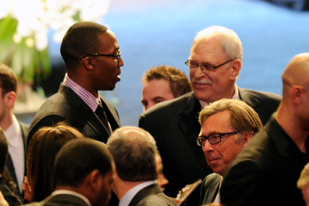 . Dwight Howard and Phil Jackson talk before the Jerry Buss Memorial Service at Nokia Theatre, Thursday, February 21, 2013. (Michael Owen Baker/Staff Photographer)
