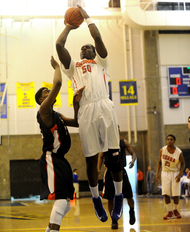 . 03-12-2013--(LANG Staff Photo by Sean Hiller)-Serra\'s Emmanual Ndumanya (50) gets a basket over Pacific Hills\'Namon Wright (12) in Tuesday\'s boys basketball IV Southern California Regional semifinal at L.A. Southwest College.