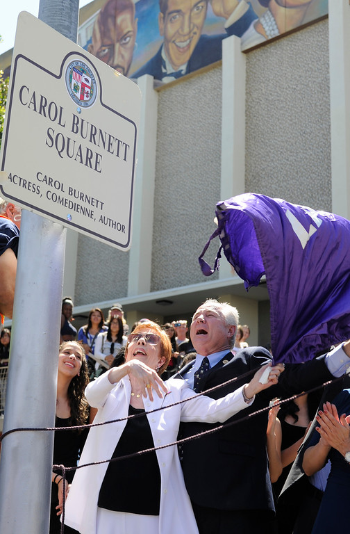 ". Carol Burnett, award-winning actress, comedienne and best-selling author, was honored by the City of Los Angeles for her lifetime achievements with the naming of Carol Burnett Square at the intersection of Highland Avenue and Selma Avenue. The Square is adjacent to Hollywood High School where Burnett attended. Students from the school choir, ""H2O\"" sang �I�m so glad we had this time together,� before Burnett and LA City Councilman Tom LaBonge unveiled her street sign. Hollywood, CA 4/18/2013(John McCoy/Staff Photographer"