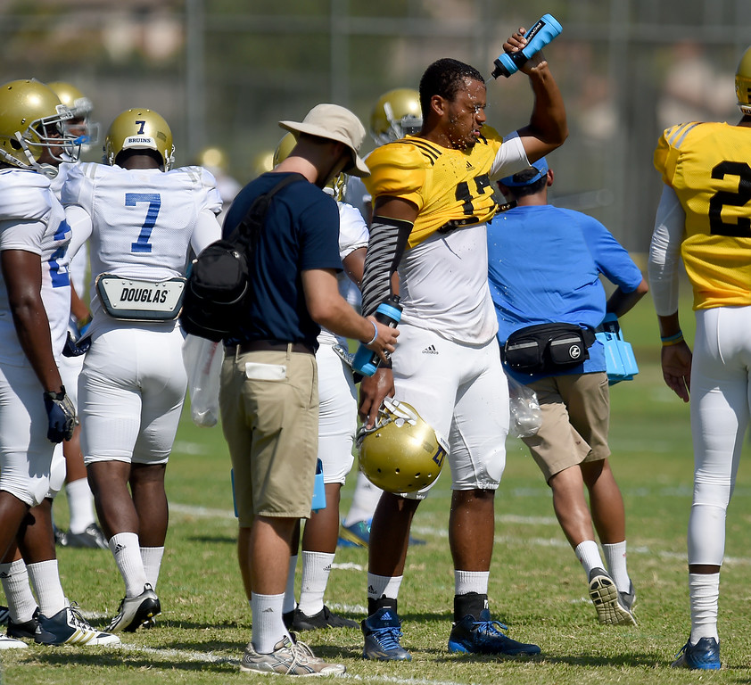 Description of . Quarterback Brett Hundley cools off during the UCLA Bruins football practice at Cal State San Bernardino in San Bernardino, CA, Friday, August 8, 2014. (Photo by Jennifer Cappuccio Maher/Inland Valley Daily Bulletin)