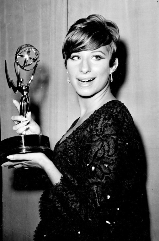 ". Broadway star Barbra Streisand shows off the Emmy statuette she won for her television special "" My Name is Barbra, \"" at New York City\'s Hilton hotel, on September 12, 1965. (AP Photo)"