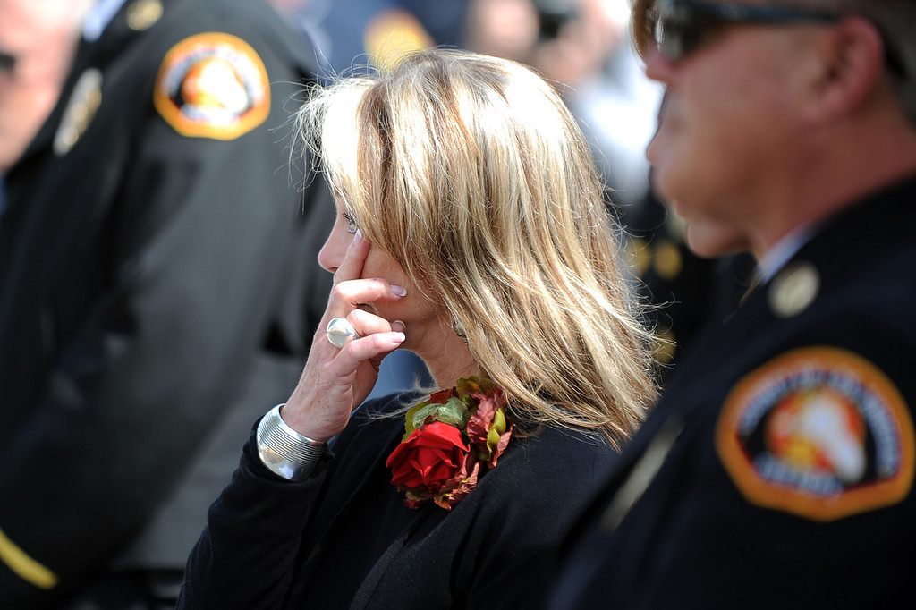 . Karen Langley-Stephen (Mother of Jeff Langley) wipes away a tear during a 20th Anniversary Memorial Ceremony for firefighter Jeff Langley March 28, 2013 at the Los Angeles County Fire Department Barton Heliport in Pacoima, CA.  Langley was killed during a 1993 Air Operations rescue in Malibu.(Andy Holzman/Staff Photographer)