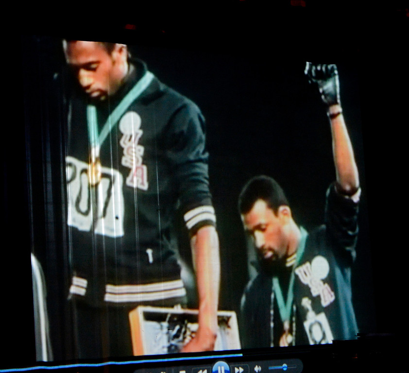 Description of . The iconic image was shown to San Bernardino High School students of Gold medalist Tommie Smith, left, and Bronze Medalist John Carlos, right,  as they raised their fists  in a Black Power salute during their medals ceremony in the 1968 Olympic Games in Mexico.  GABRIEL LUIS ACOSTA/STAFF PHOTOGRAPHER.