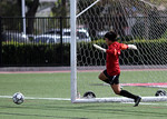 Rebecca sends the ball just inside the post but it is kicked away by the goalie.