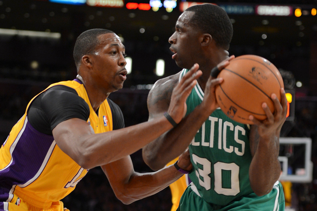 . Lakers Dwight Howard defends against Celtics\' Brandon Bass during first half action at Staples Wednesday.  Photo by David Crane/Staff Photographer
